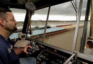 Flooding strands 100-plus barges on Mississippi