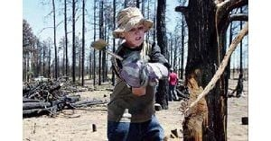 04/27 - Boy Scouts clear away fire debris