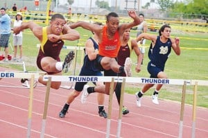 <p>Corona del Sol's Tevin Mayfield, middle in orange, battled it out at in the 110-meter hurdles with Mayfield getting the win by 0.01 tenths of a second at 15:38.</p>