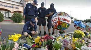Spirit of fallen cop looms over killing scene