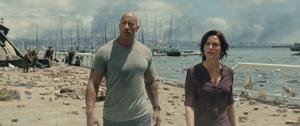<p>Dwayne Johnson, left, as Ray, and Carla Gugino as Emma, survey the damage in a scene from the action thriller, <em>San Andreas</em>. [Warner Bros. Pictures/AP]</p>