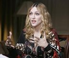 Adopted boy's father praises Madonna