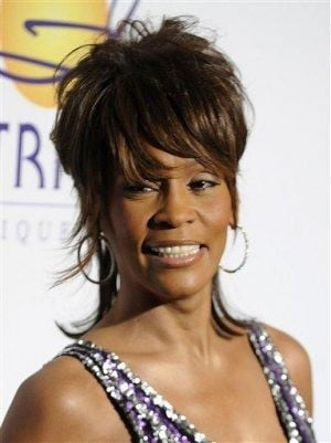 Whitney Houston denies reunion with ex Bobby Brown