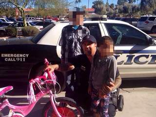 Mesa officer buys kidnap victim new bike