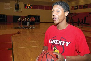 Liberty senior foregos typical path to hoops stardom
