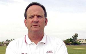 Basha hires Busken as football coach