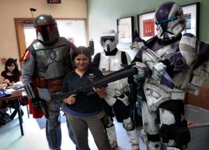 <p>Chandler Public Library Assistant Elisia Simmons stands with Star Wars charaters during the 2014 LibCon.</p>