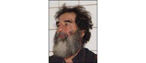 Iraqis get custody of Saddam, 11 others