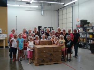 Riggs Elementary students make meals for starving children