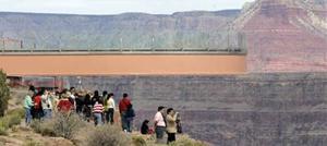 Tribe attaches massive steel bridge at edge of Grand Canyon