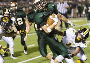 <p>Campo Verde's wide receiver Erik Hildebrandt (2) attempts to evade Goldwater's defense during the football game between Campo Verde and Goldwater at Campo Verde High School on Friday, Aug. 22, 2014.</p>