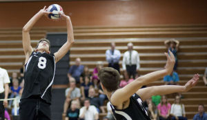<p>Highland's Jayce Ashment (8) sets the ball during the volleyball game between Highland and Perry at Highland High School on Thursday, April 17, 2014.</p>