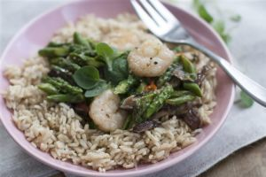 <p>This March 31, 2014 photo shows pan seared asparagus with shrimp, shiitakes, and chilies in Concord, N.H. (AP Photo/Matthew Mead)</p>