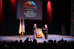 <p>John Giles is sworn in by Dr. Paul Eppinger as the 40th Mayor of Mesa on Sept. 18th, 2014</p>