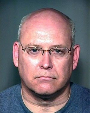Chandler official cited in woman's assault