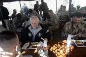 Cheney visits Iraq; attacks kill 19