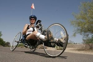 Woman defies odds, plans to hand-cycle over United States