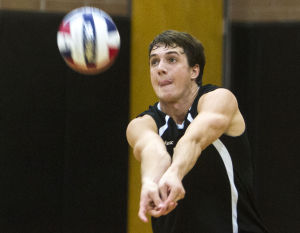 Volleyball: Highland Vs Perry: Highland's Sean Chapman (5) hits the ball during the volleyball game between Highland and Perry at Highland High School on Thursday, April 17, 2014. - [David Jolkovski/Tribune]