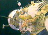 Astronauts install robotic arm on station