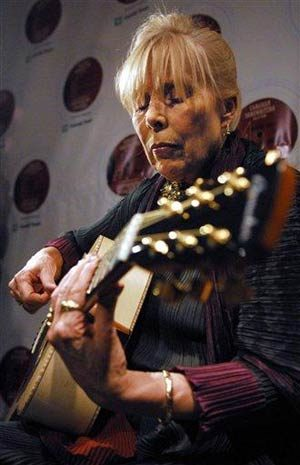 Starbucks label signs Joni Mitchell