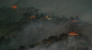Wildfire burns homes in coastal Calif. enclave