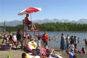 <p>In this photo taken Monday, June 17, 2013, people swim and sunbathe at Goose Lake in Anchorage, Alaska. Alaska's largest city and other parts of the state are experiencing a long stretch of higher than normal temperatures. (AP Photo/Rachel D'Oro)</p>