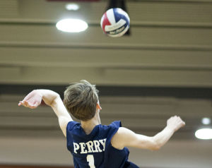Volleyball: Highland Vs Perry: Perry's Wyatt Veach (1) hits the ball during the volleyball game between Highland and Perry at Highland High School on Thursday, April 17, 2014. - [David Jolkovski/Tribune]