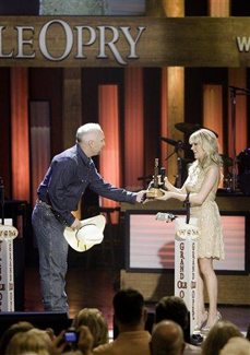 Former 'Idol' winner Carrie Underwood joins Grand Ole Opry
