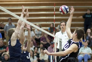 Volleyball: Highland Vs Perry: Highland's Max Pothier (10) hits the ball during the volleyball game between Highland and Perry at Highland High School on Thursday, April 17, 2014. - [David Jolkovski/Tribune]