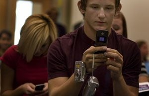 Teens text to peers in dating violence awareness session