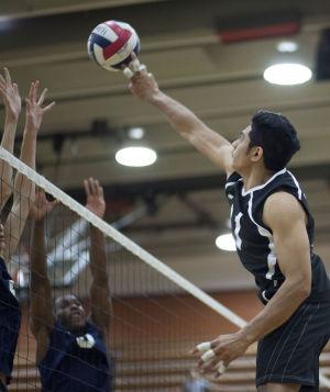 Volleyball: Highland Vs Perry: Highland's Jemesa Snuka (11) hits the ball during the volleyball game between Highland and Perry at Highland High School on Thursday, April 17, 2014. - [David Jolkovski/Tribune]