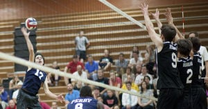 Volleyball: Highland Vs Perry: Perry's Brandon Grebe (17) hits the ball during the volleyball game between Highland and Perry at Highland High School on Thursday, April 17, 2014. - [David Jolkovski/Tribune]