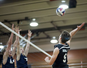 Volleyball: Highland Vs Perry: Highland's Curtis Lunt (9) hits the ball during the volleyball game between Highland and Perry at Highland High School on Thursday, April 17, 2014. - [David Jolkovski/Tribune]