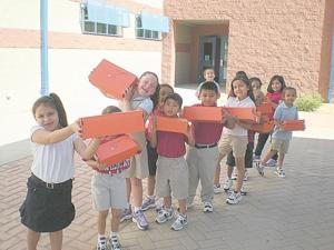 Aguilar Elementary students get new shoes