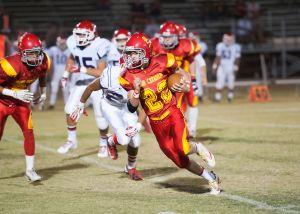 <p>Seton Catholic's Anthony Campenella runs for a long gain on a sweep against Coronado during their football game, Friday, Sept. 27, 2013, at Seton Catholic Prep in Chandler. [Greg Herriman/Special to Tribune]</p>