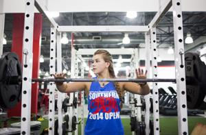 <p>Gilbert High powerlifter Sara Olguin prepares to work out at Power MMA & Fitness in Gilbert on Wednesday, Oct. 15, 2014.</p>