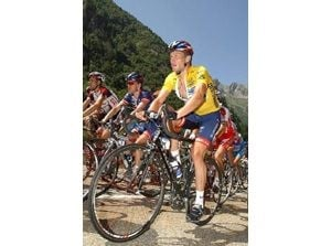 Armstrong wins hill climb, extends lead