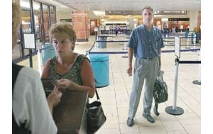 Travelers take tightened airport security in stride