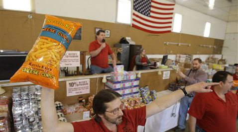 Bargain-hunters buying groceries at auction