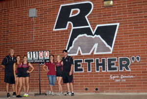 <p>This was the first time in school history three girls cleared 11 feet in the same meet for Red Mountain. From left to right: assistant pole vault coach Blair Howland, Abbie Sharkey, Kristiana Warth, pole vault coach Cara Manis, Tayler Jameson, and girls track coach Brent Krieg.</p>