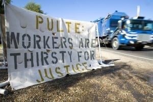 Small group of protesters rallies against Pulte