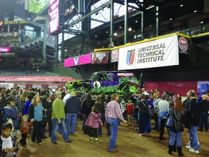 <p>Fans mull around the Grave Digger at Monster Jam [Courtesy Wendy O'Neal]</p>