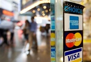 Fed: Banks eye tighter terms on credit cards
