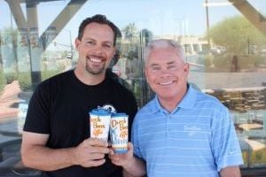 <p>Jim Thompson, left, celebrates the opening of his 13th Dutch Bros. Coffee Drive Thru, in Gilbert, with free coffee on Dec. 13, 2013.</p>