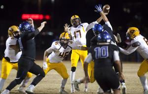 <p>Mountain Pointe quarterback Garvin Alston (17) passes the ball during the DI semifinals football game between Mountain Pointe and Chandler at Hamilton High School on Friday, Nov. 21, 2014.</p>