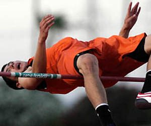 Senior high jumper trying for 7-2 mark at Rotary meet
