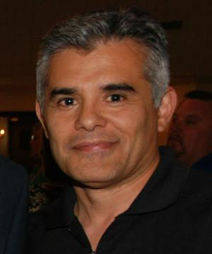 <p>Basha wrestling coach Mike Garcia [Submitted photo]</p>