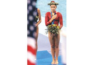 Dazzling Patterson wins all-around gold