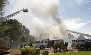 Firefighters battle Tempe house fire