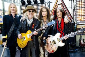 """<p>FILE - This Nov. 2, 2012 file photo shows, from left, Tom Hamilton, Brad Whitford, Steven Tyler and Joe Perry of Aerosmith perform on NBC's """"Today"""" show in New York. Aerosmith, James Taylor, and Jimmy Buffett are among the scheduled performers for a Boston Marathon benefit concert May 30. The show, at the TD Garden, will benefit One Fund _ the collection of donations that will be distributed to the survivors of the April 15 bombings and the families of those killed in the attack.</p>"""